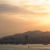 Sun starts to set over Haeundae Beach and Gwangan Bridge, Busan, South Korea