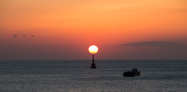Sunrise above buoy, Haeundae Beach, Busan