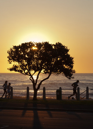 Cape Town joggers at sunset