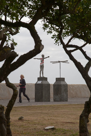 Sculpture and jogger on the promenade