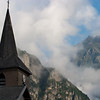 Church tower, mountains and clouds