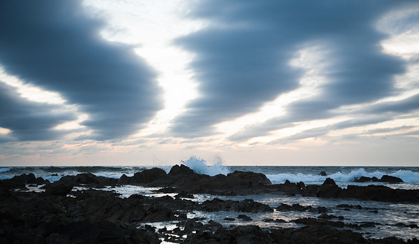 Rocks, waves and clouds