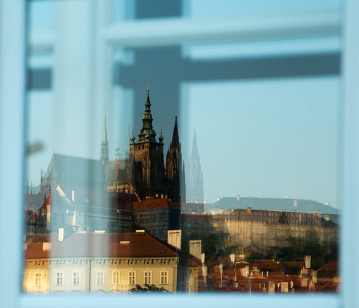 Prague castle reflected in a window