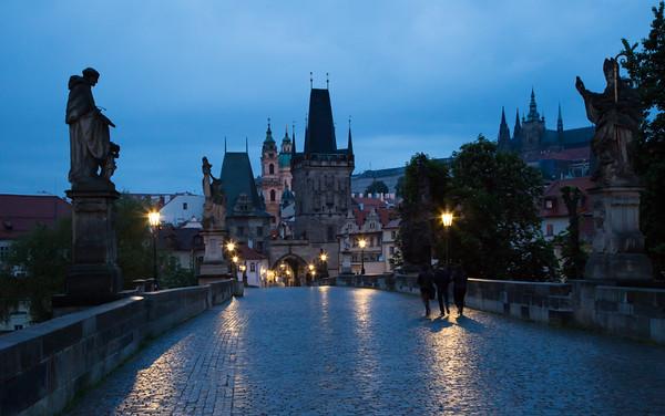 Wet pre-dawn view of Charles Bridge and Prague Castle