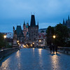 Wet pre-dawn view of Charles Bridge and Prague Castle