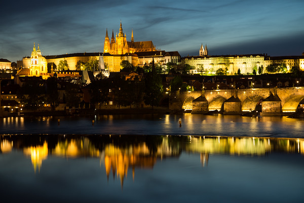 Floodlit Charles bridge and Prague castle, taken from southeast bank