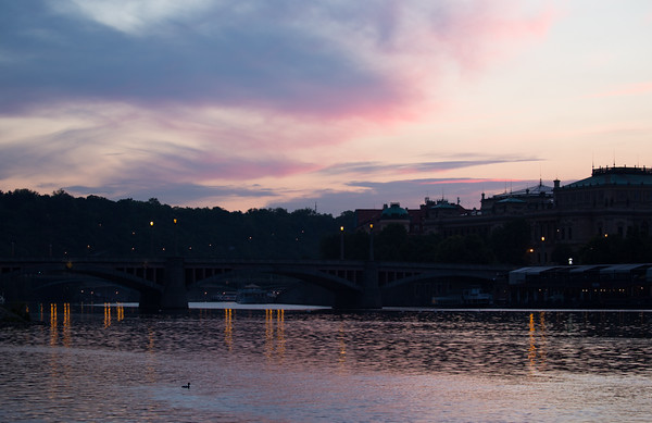 Pre-dawn view of clouds, reflections and Manes Bridge from the western end of the Charles Bridge, Prague
