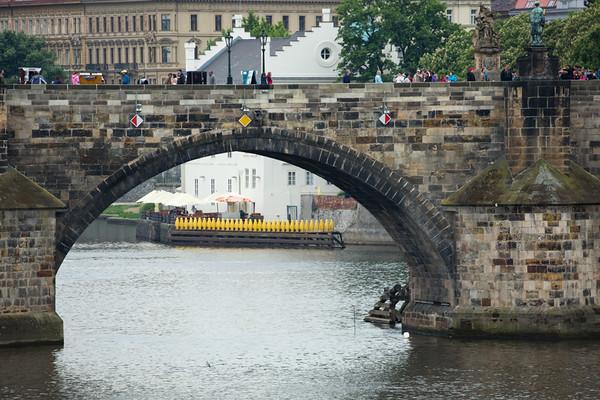 Medieval Charles bridge frames modern penguins at the Kampa museum, Prague