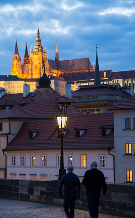 Floodlit Prague castle seen from Charles bridge