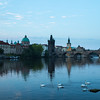 Pre-dawn view of Charles bridge and dome of Church of St Francis of Assisi from the northwest bank of the river Vltava