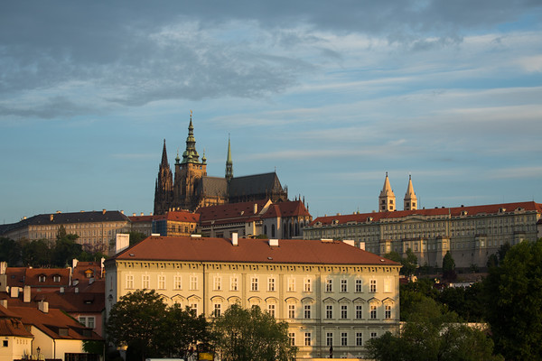 Early morning sunlight catches the spires of St Vitus Cathedral and Prague Castle