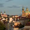 Early morning sunlight catches the towers and spires of the Lesser Quarter (Mala Strana), Prague