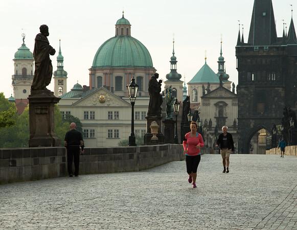Early morning jogger on Charles Bridge, Prague