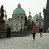 Early morning jogger on Charles Bridge, Prague