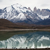 Tourists view the reflection of Cuernos del Paine in Lago Sarmiento, Chilean Patagonia
