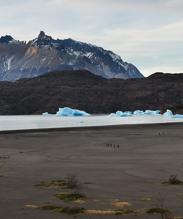 Icebergs on Lago Grey with peaks of Torres del Paine National Park in the background, Chilean Patagonia