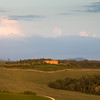 The Full moon rises over a Tuscan farm