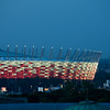Floodlit stadium and chimney, Warsaw, Poland