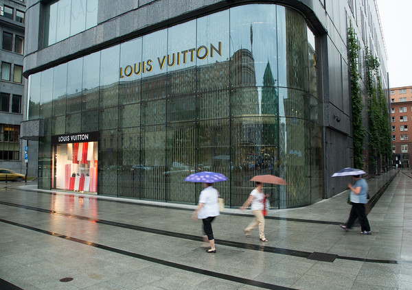 Wet Warsaw street and Louis Vuitton reflections, Warsaw, Poland