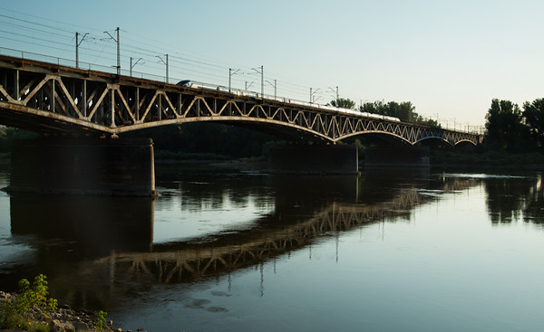 Early morning express train on Vistula River bridge , Warsaw, Poland