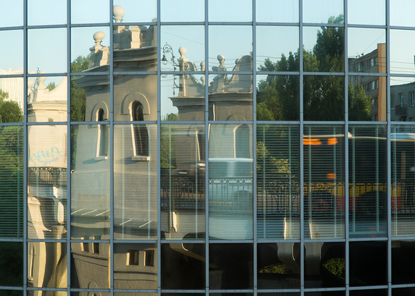 Reflections in office windows of bridge and overpass in Warsaw, Poland