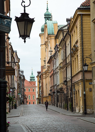Warsaw Old Town street view with St Martin's Church and the Royal Castle