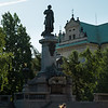 Striding to work, monument to Adam Mickiewicz, Warsaw, Poland