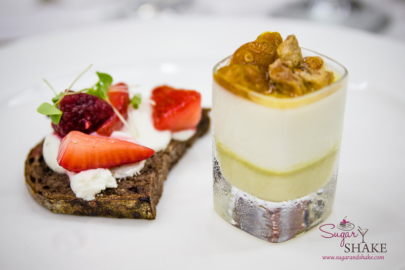 """Chef Eric Faivre prepared an incredible cheese course, which he called a """"pre-dessert."""" On the left: Surfing Goat Dairy cheese on chocolate sourdough bread with macerated fruits. On the right: A pistachio goat cheese panacotta topped with pistachios and poha berries. © 2014 Sugar + Shake"""