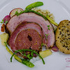 "From Charcut Roast House in Calgary, Chefs John Jackson and Connie DeSousa served what they affectionately called ""Pork Stuffed With Pork."" Made with Maui pork, the belly and loin were wrapped around a kielbasa-style sausage made with the pork shoulder and heart. Plus local veggies, sea asparagus, coconut bone marrow foam and an amazing ""cracker,"" actually a First Nations flat bread with heirloom seeds. © 2014 Sugar + Shake"