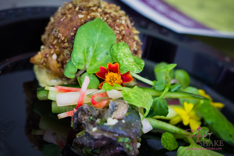 Maui AgFest 2013 Grand Taste Education Dish: Chef Isaac Bancaco (Pineapple Grill) with Monica Bogar (Napili-Flo Aquaponics) — Escargot and Lemongrass Guanciale Bahn Mi, Watercress, Pickled Watermelon Radish and Micro Marigold. © 2013 Sugar + Shake