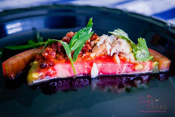 "Maui AgFest 2014 Grand Tasting: Chef Sheldon Simeon (Migrant / Māla Wailea) with Olowalu Nui Farm — Olowalu Tomato, Confit 'Ahi Kama, Hawaiian Chili ""Piri Piri,"" Chouriço. Culinary Influence: Portuguese. © 2014 Sugar + Shake"