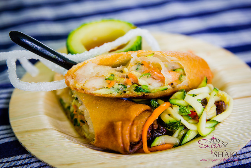 Maui AgFest 2014 Grand Tasting: Chef Tylun Pang (Kō at the Fairmont Kea Lani, Maui) with Fernando Traje (Traje Farms) — Zucchini and Shrimp Lumpia with Zucchini Achara. Culinary Influence: Filipino. Second Place, Judges' Choice and Fan Favorite. © 2014 Sugar + Shake