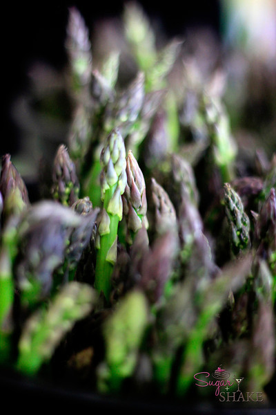 "Had the ""wrong"" light setting on the camera, which, when done intentionally results in dramatic shots like lighting up just one spear of asparagus. The farmer tried to get us to buy a bunch, saying, ""Then you can take it home and eat it, instead of just taking photos!"" © 2012 Sugar + Shake"