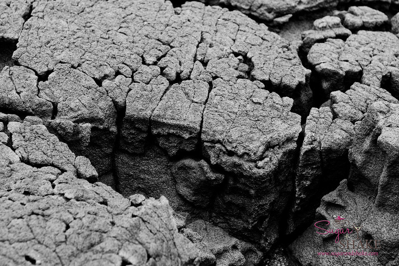 Some of the lava rock at Punalu'u Black Sand Beach. This gets worn down to create the black sand. © 2012 Sugar + Shake