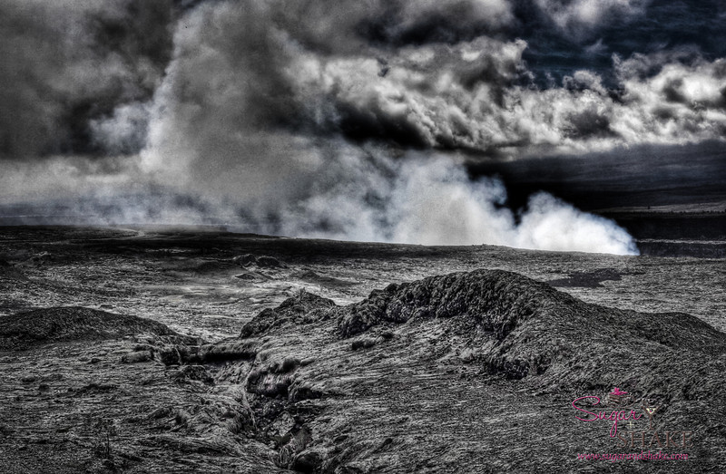 """Welcome to Mordor. On a tip from a ranger friend, we hiked out to Keanakakoi Crater, a newly re-opened trail. This is a view of Kïlauea Crater, seen earlier, but from the """"backside."""" As our friend noted, it seems like you're closer to the crater than the view from Jagger Museum, but it's really not — it's just that the angle of view is different. © 2012 Sugar + Shake"""