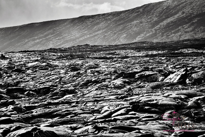 Lava field landscape. This type of lava seen in the foreground is called pahoehoe — it's smooth and liquid-y looking. © 2012 Sugar + Shake