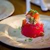 "Kā'anapali 5-0 Dinner: ""'Ahi Blossom"" by Chef Greg Grohowski of Hyatt Regency Maui Resort. Hawaiian big eye tuna with a sushi rice center, topped with opilio crab, tobanjan sauce & green onion. © 2013 Sugar + Shake"