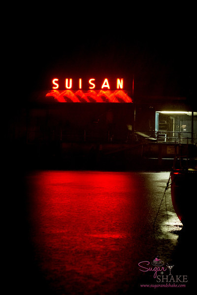 Suisan, an old Hilo fixture, is part of a fishing and food distribution company. They have a cool neon sign that reflects off the water in their little section of the harbor. © 2013 Sugar + Shake