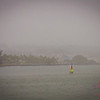 Rainy day in Hilo Bay. The rain clouds started drifting in, but the folks in this colorful sailboat never gave up. © 2013 Sugar + Shake