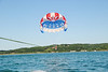 Towards the end of the parasail trip, they bring the rope down low.
