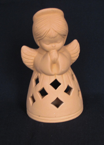 This little angel has been praying among our decorations since the 70's.
