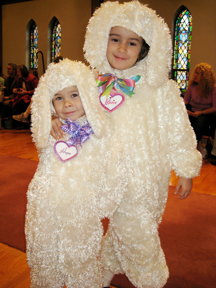These puppy costumes became lambs in the Christmas play.
