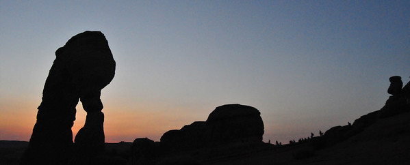 A crowd gathered,<br /> hoping the full moon would rise<br /> through Delicate Arch.