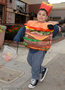 6-year-old Christopher Dennison smiles in his cheeseburger costume during Treat Street in downtown Chico, Calif. Monday Oct. 31, 2016. (Bill Husa -- Enterprise-Record)