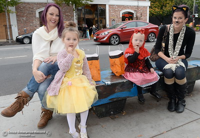 Grandma Lisa Cufaude smiles beside 4-year-old Audrey Murgia, Kinsley Murgia, 1, and daughter Tierra Murgia at right as they take a break during Treat Street in downtown Chico, Calif. Monday Oct. 31, 2016. (Bill Husa -- Enterprise-Record)