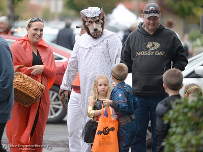 Little trick or treaters react to spotting the Big Bad Wolf during Treat Street in downtown Chico, Calif. Monday Oct. 31, 2016. (Bill Husa -- Enterprise-Record)