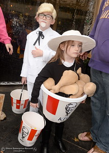 10-year-old Nathan Wells is The Colonel while 6-year-old Samantha is a bucket of chicken as they get candy during Treat Street in downtown Chico, Calif. Monday Oct. 31, 2016. (Bill Husa -- Enterprise-Record)