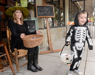4-year-old Dean Hedrick smiles as he gets a piece of candy from Brittney Ladd at 3 Seas during Treat Street in downtown Chico, Calif. Monday Oct. 31, 2016. (Bill Husa -- Enterprise-Record)