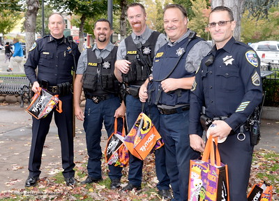 Members of the Chico Police Department hand out candy during Treat Street in downtown Chico, Calif. Monday Oct. 31, 2016. (Bill Husa -- Enterprise-Record)