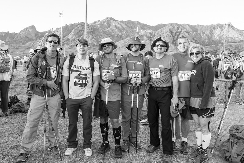 Steve Baskis, his brother Kevin, Nate Gorham, Tim Hornik, Lonnie Bedwell, Dan Standage and wife Nancy pose for a photo prior to starting the Bataan Death March.
